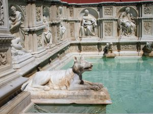 Statue of dog on the Gaia Fountain   in Siena